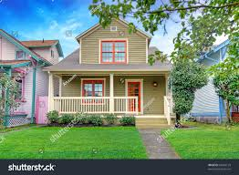 cute craftsman style small green house stock photo 68435125
