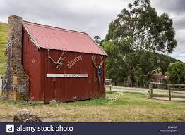 red tin shed with brickwork chimney on petuna farm new zealand