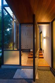 pivot closet doors porch modern with ceiling fan concrete floor