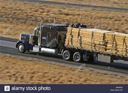 Lumbar 84 by Big Rig Truck Hauling Lumber On Interstate Highway I 84 Northern