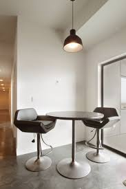houses elegant breakfast dining table with brown high seating on