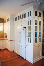 love these cabinets and how they wrap around the refrigerator