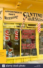 old fashinoned hairdressers and there salon potos yellow painted old fashioned traditional mens hairdresser barber