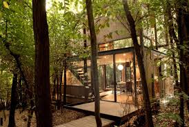 This Small House by This Small 2 Story House Sits In A Deciduous Forest On The