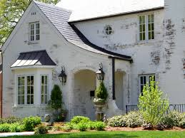 exterior painted brick houses with roof and window treatments