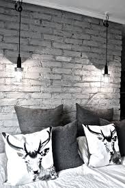 great masculine bedroom grey brick grey bed linens white