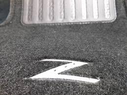 nissan frontier floor mats nissan 03 05 350z carpeted black floor mats black