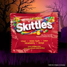 halloween grabbing hand bowl skittles starburst life savers and hubba bubba gum halloween