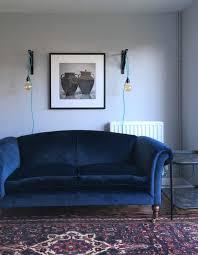 navy blue velvet sofa persian rug sitting room lounge dulux