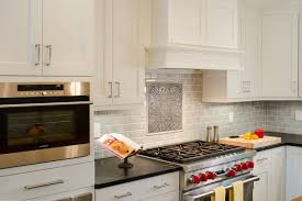 modern kitchen remodel with elmwood cabinets and wolf duel range