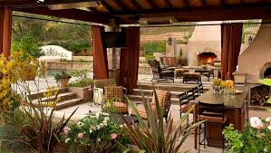 outdoor living room with table and floor and sofa and fireplace
