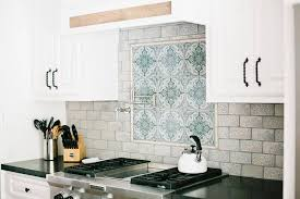blue kitchen backsplash white cabinets black granite countertops styles tips infographic