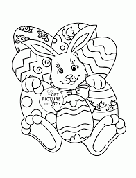 easter bunny with many eggs coloring page for kids holiday