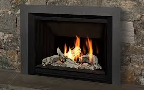 valor 1100i h5 series gas direct vent fireplace or insert with pebble beach driftwood fire installed with 4 sided black trim kit fluted black li