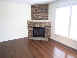 gallery of traditional corner stone fireplace designs corner fireplaces regarding corner fireplace ideas in stone