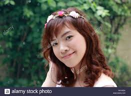 asian headband pretty asian woman with flower headband in the park stock