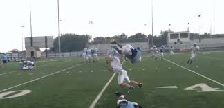 High School Football Player's Front Flip Over Defender