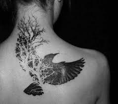 sugar skull bird black bird of tree tattoos on back