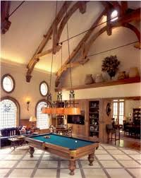 home billiard room design with classic wooden pool table and high
