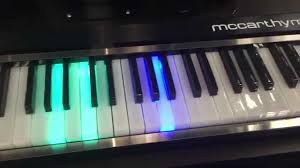keyboard that lights up to teach you how to play mccarthy music unveils the new illuminating piano at namm 2015 youtube