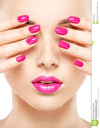 close up face of a beautiful with pink nails and lips stock