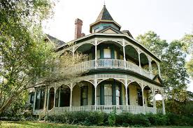 white old gothic revival victorian house design featuring steep