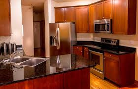 best for cherry kitchen cabinets what color quartz countertops go with cherry cabinets