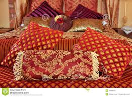 Red Bed Cushions Luxurious Cushions On Bed In Gold Brocade Stock Photo Image