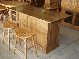 kitchen islands oak solid oak amish made raised panel kitchen island or bar on wheels