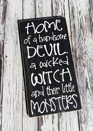 happy halloween sign black and white home of a handsome devil a wicked witch and their little