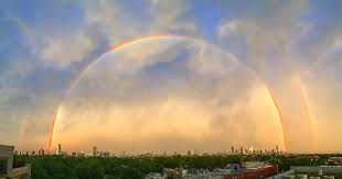 a double rainbow over chicago colossal