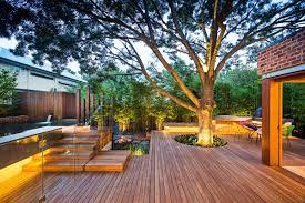 family members entertaining modern backyard style for outside