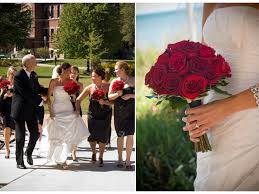 bride wears white strapless wedding dress holds red rose bridal