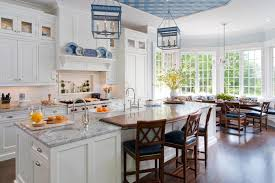 bright english kitchen style with white cabinetry and a long