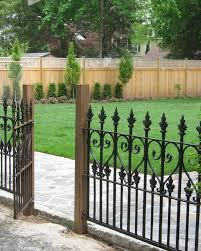 graceful garden fence design ideas with black iron ornate railing
