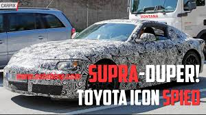 toyota supra spied winter testing alongside the bmw z5 convertible