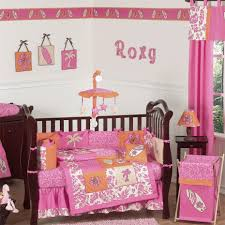 bedroom simple wooden crib decorate with pink floral baby