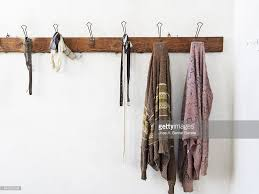 wooden coat rack wall hanging with old clothes stock photo getty