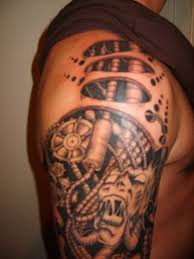 the best shoulder tattoos designs this shoulder and arm tattoo looks great biomechanical tattoo