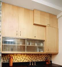 glass kitchen cabinets sliding doors an exle of vertical cabinets hung horizontal sliding