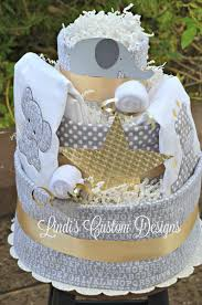 silver gold and gray elephant giraffe diaper cake with blankets