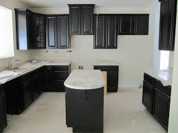 espresso kitchen cabinets and island with white marble countertop