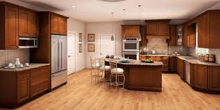 appealing light cherry wood kitchen cabinets below solid surface