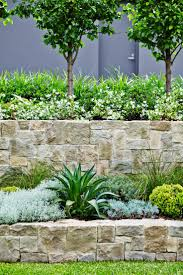 Beautiful Tiered Stone Walls Softened By Plantings Trees At