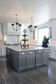concrete countertops gray and white kitchen cabinets lighting