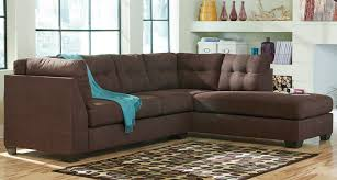 benchcraft maier sectional with right side facing chaise in walnut