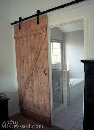 barn door ideas for bathroom open concept kitchen catwalk stone fireplace sliding door mountain