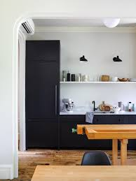 kitchen cabinets in brooklyn small streamlined brooklyn kitchen with black cabinets by