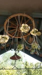 Diy Wagon Wheel Chandelier Diy Wagon Wheel Chandelier For Wedding Can U0027t Wait To See It