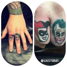 rad finger tattoos featuring harley quinn and the joker from